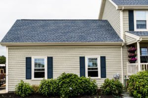House with new vinyl siding, replacement roof & windows in MA by Marshall Building & Remodeling