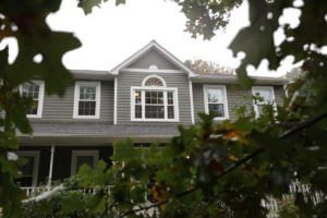 Harvey Elite Windows with Colonial Grids Installed on MA Colonial Home with Gray Vinyl Siding