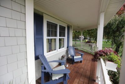 Mastic Cedar Discovery 5″ Siding in Tuscan Olive with White Cameo Trim Installed on RI Home