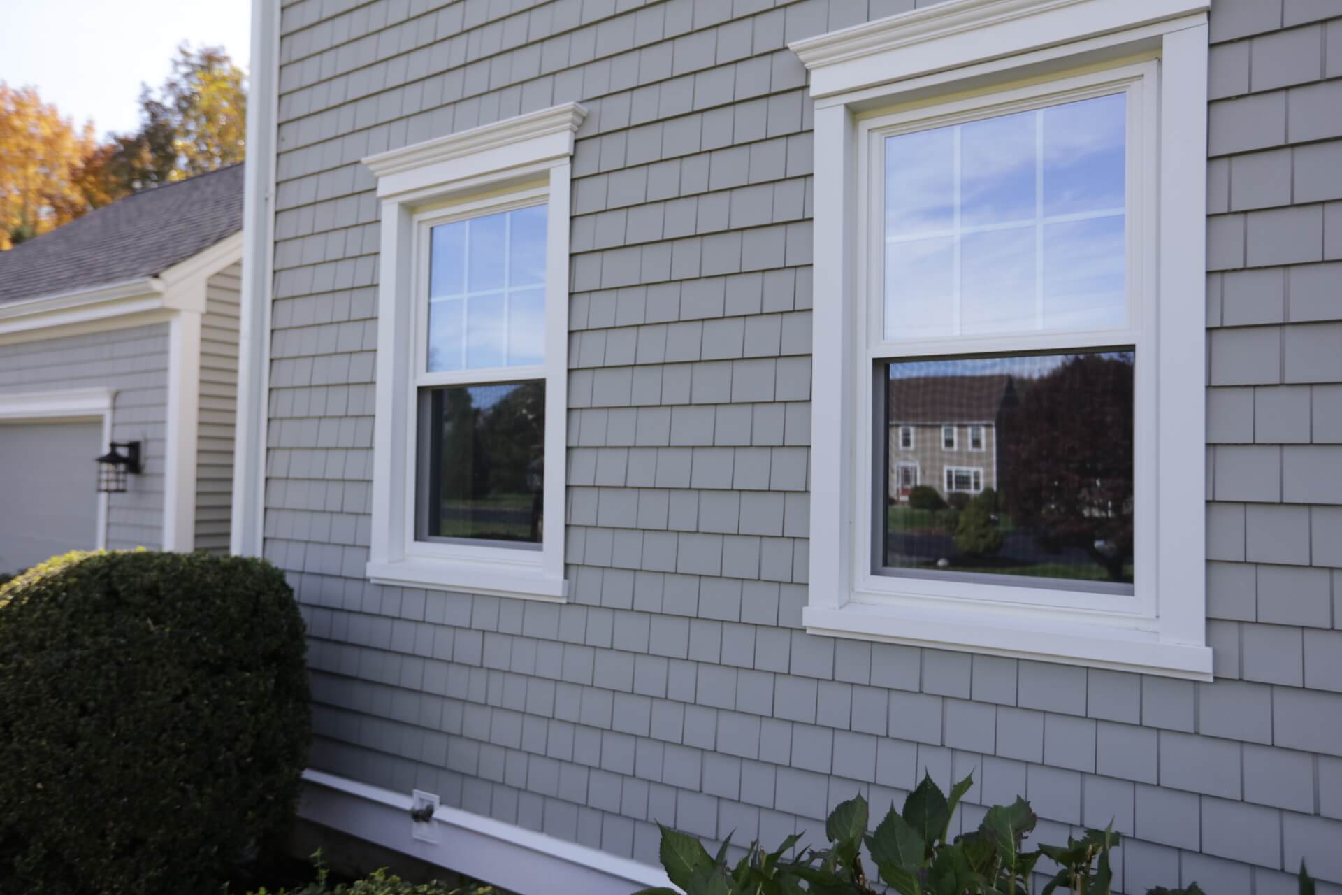 Siding & replacement window details on a home in RI