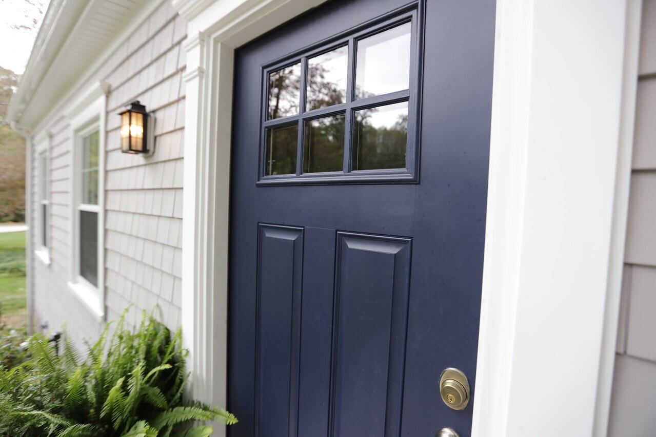 Cedar Impressions Siding and Door Trim Detail Installed Around Navy Blue Door on RI Home