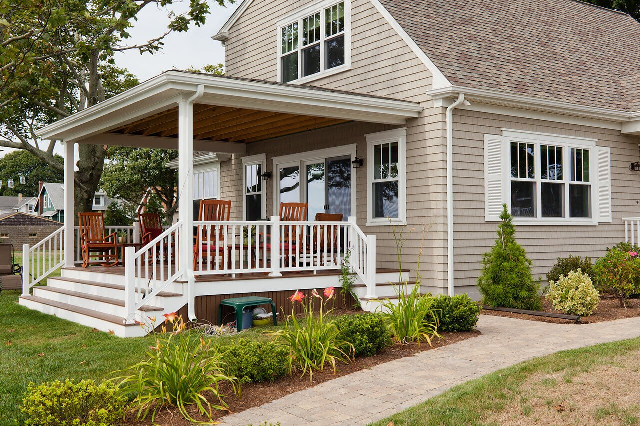 Natural Wood Look Siding Installed on Beachy Home by RI Vinyl Siding Installers Marshall Building & Remodeling