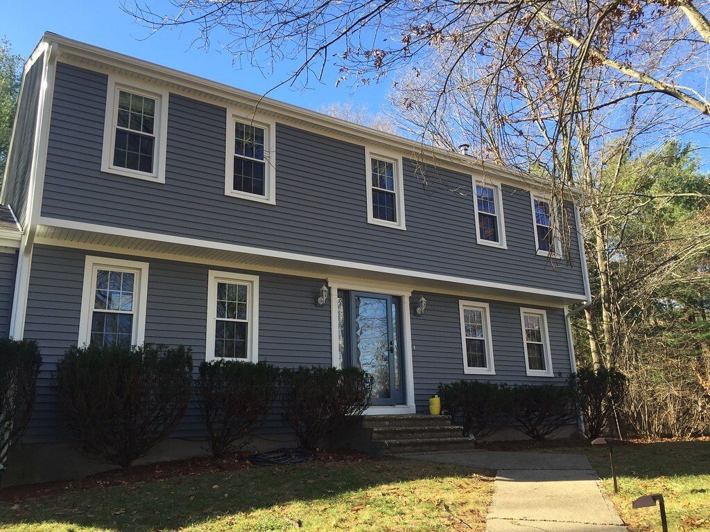 Gray Vinyl Siding and Window Installation on a Raised Ranch Home in MA