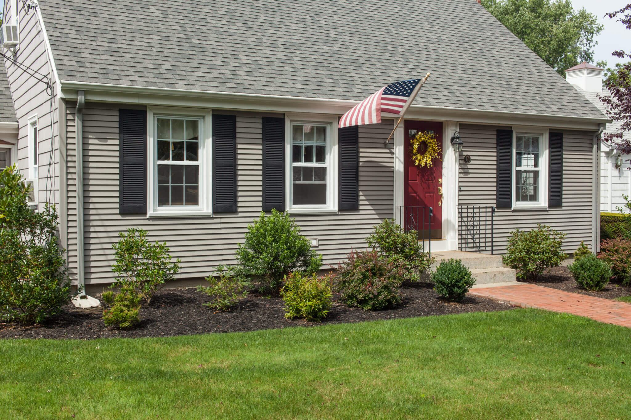 Roofing, Siding, & Windows Installed on RI Cape House by Marshall Building & Remodeling