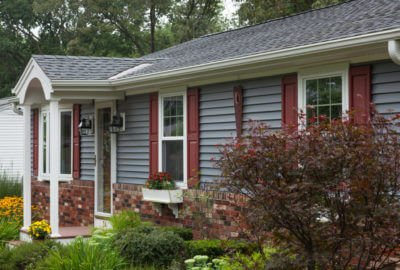 Blue Clapboard Siding with Maroon Shutters Installed on a Massachusetts Home by Marshall Building & Remodeling