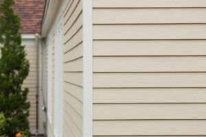 Cream Vinyl Siding Installation on MA Home by Marshall Building & Remodeling