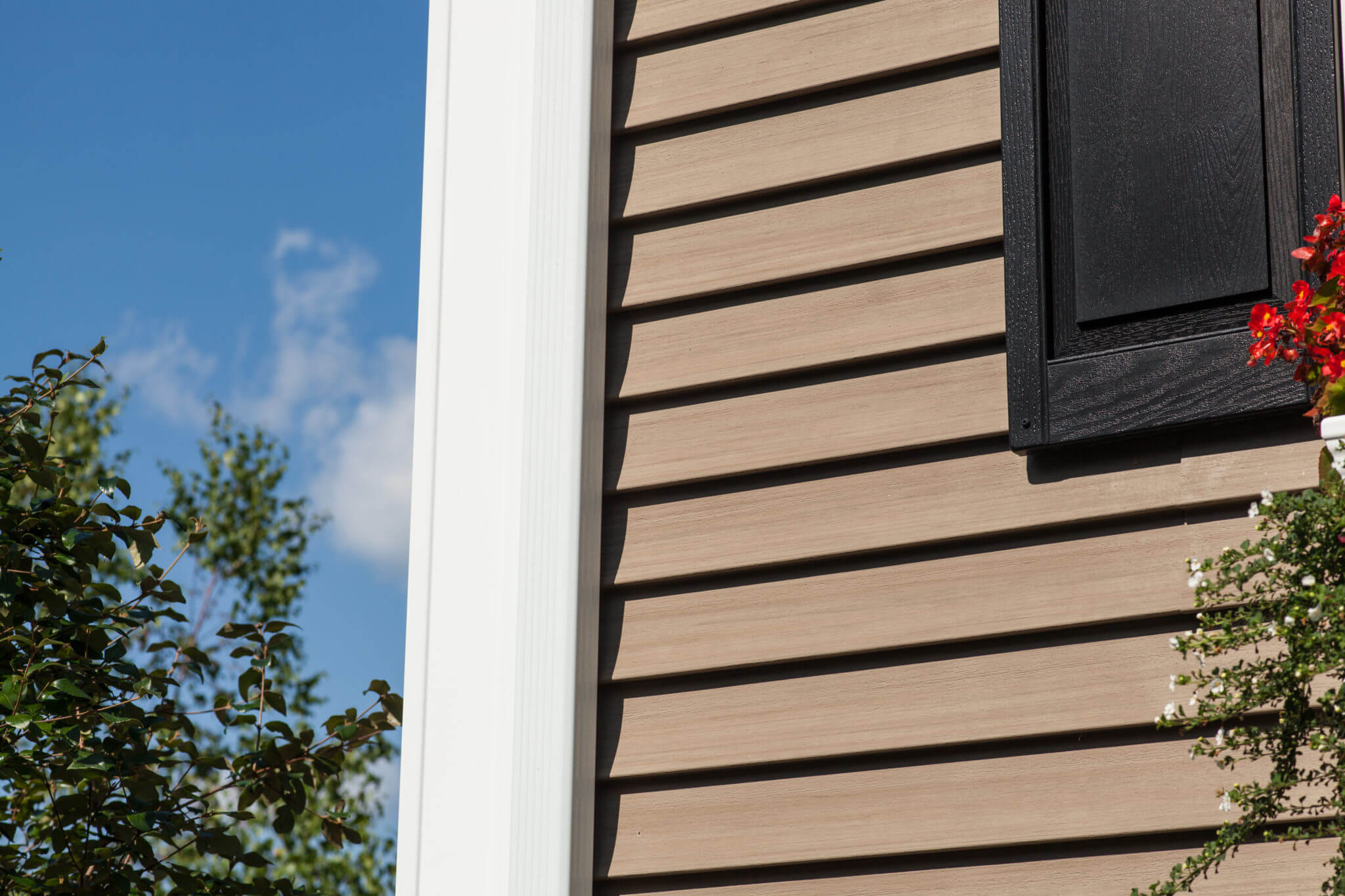 Close Up of Vinyl Siding in Tan And Black Trim Details on RI Home