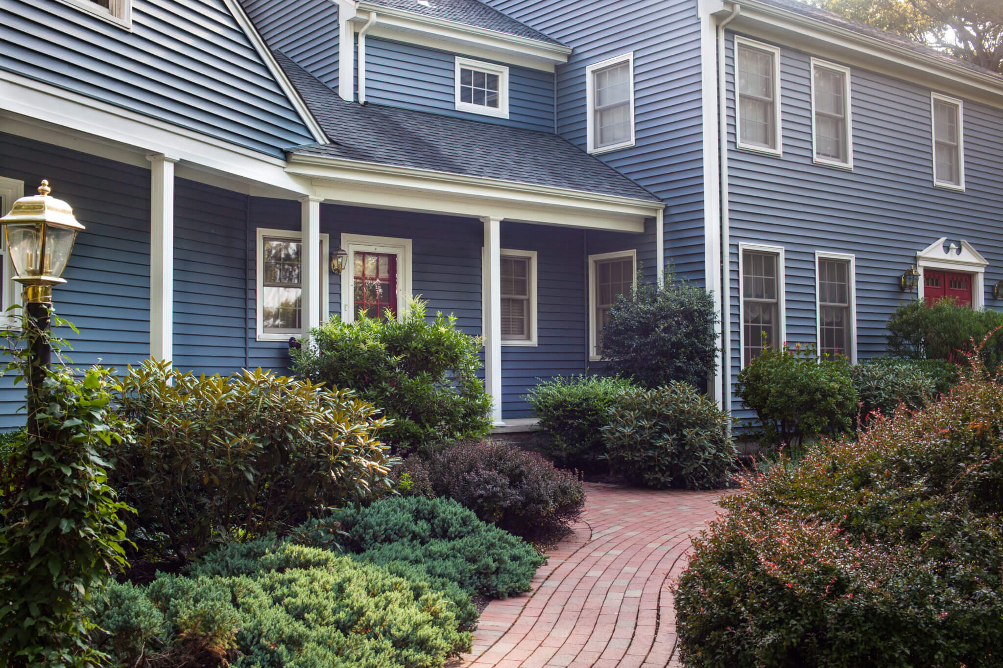 Blue Vinyl Siding Installed on a Remodeled Colonial Home in RI by Marshall Building & Remodeling