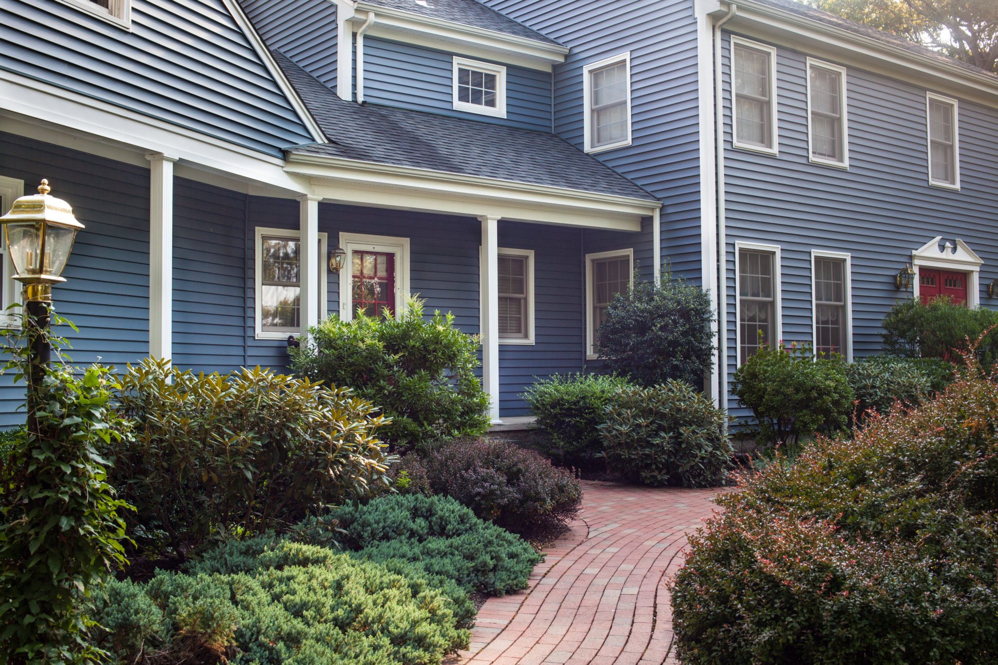 RI Renovated Colonial Home with Striking Blue Vinyl Siding by Roofers Marshall Building & Remodeling