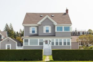 RI Home with Newly Renovated Roofing, Siding, and Windows Installed by Contractors Marshall Building & Remodeling