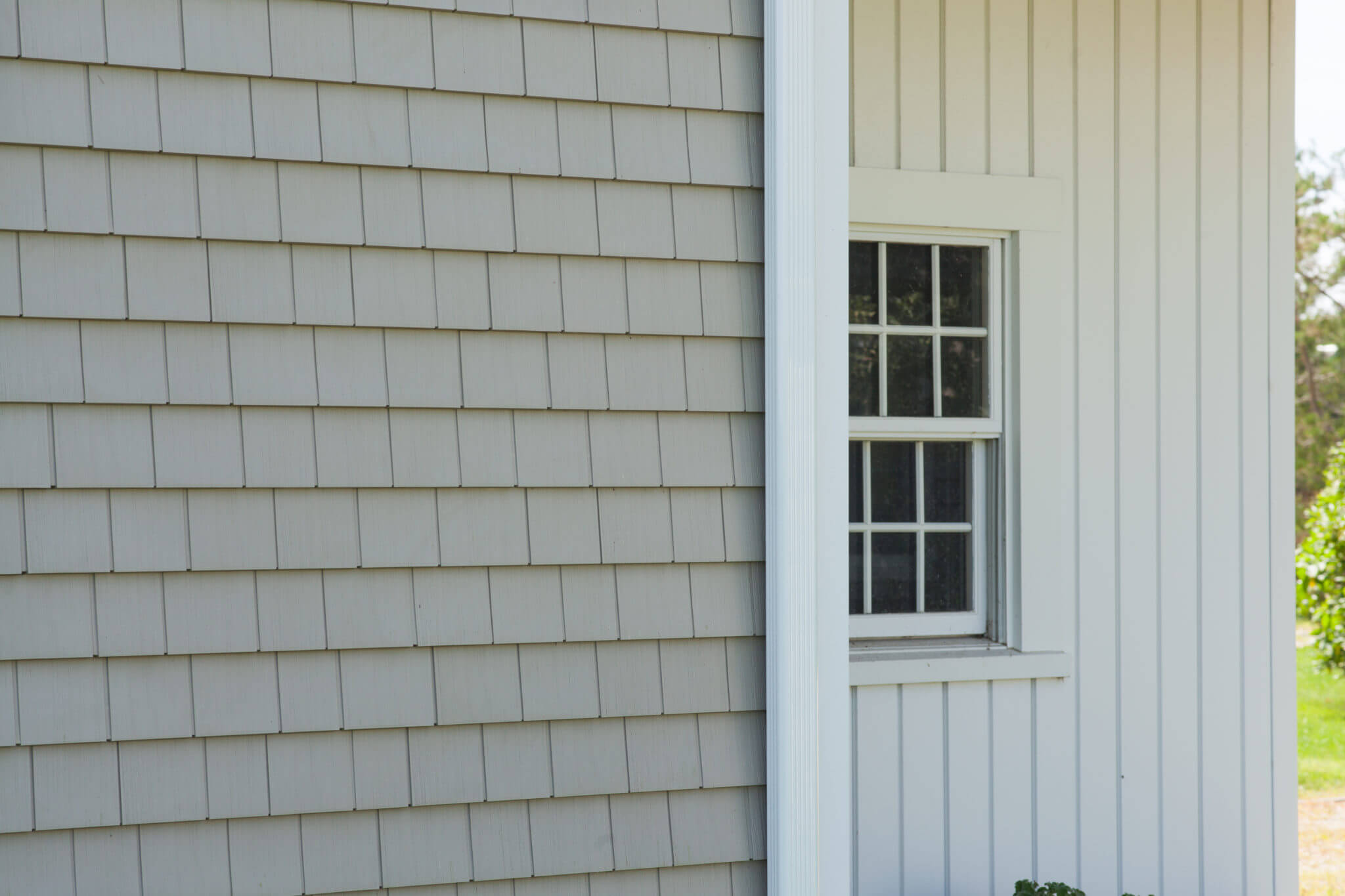RI Home Exterior with Cedar Style Vinyl Siding and Vertical Vinyl Siding