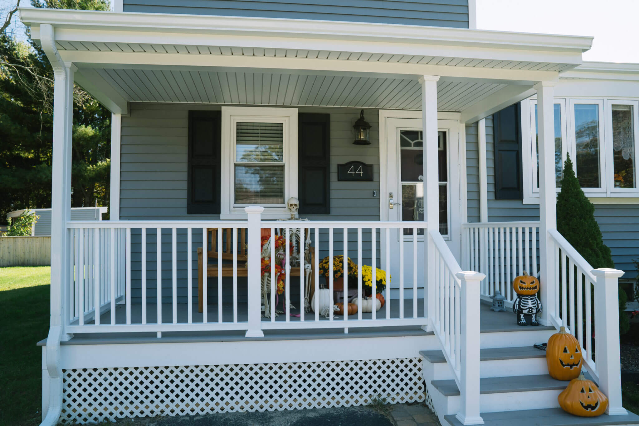 Remodeled RI Home Exterior with Mystic Ovation Clapboard Siding, New Windows, and Porch