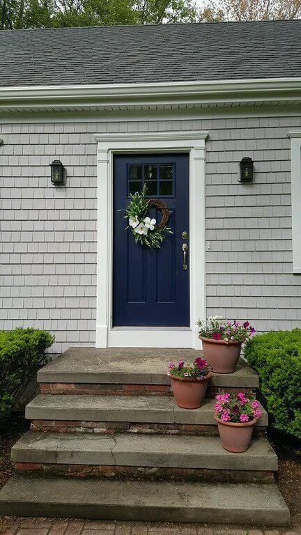 Cedar Impressions Siding and Door Trim Detail Around Beautiful Blue Door in Massachusetts