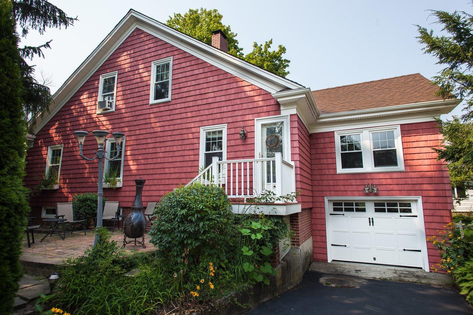Barn Red Vinyl Siding on Barrington Home