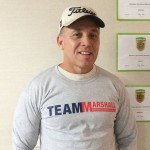 Man Wearing Gray Team Marshall T-Shirt from Marshall Building & Remodeling